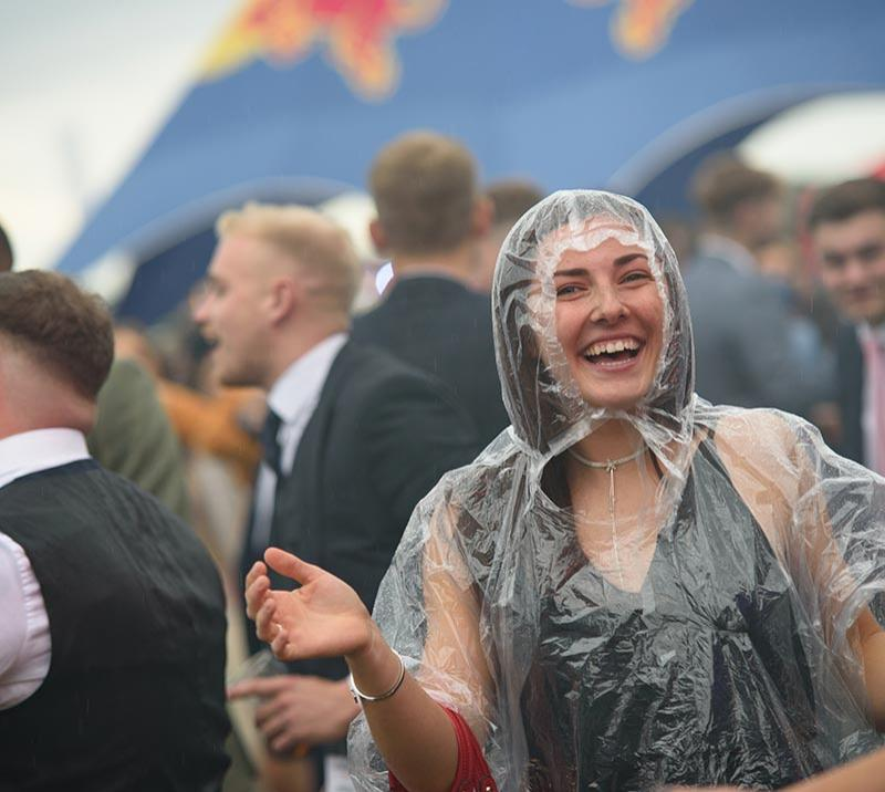 Lady enjoying the racing in a rain mack at Doncaster Racecourse