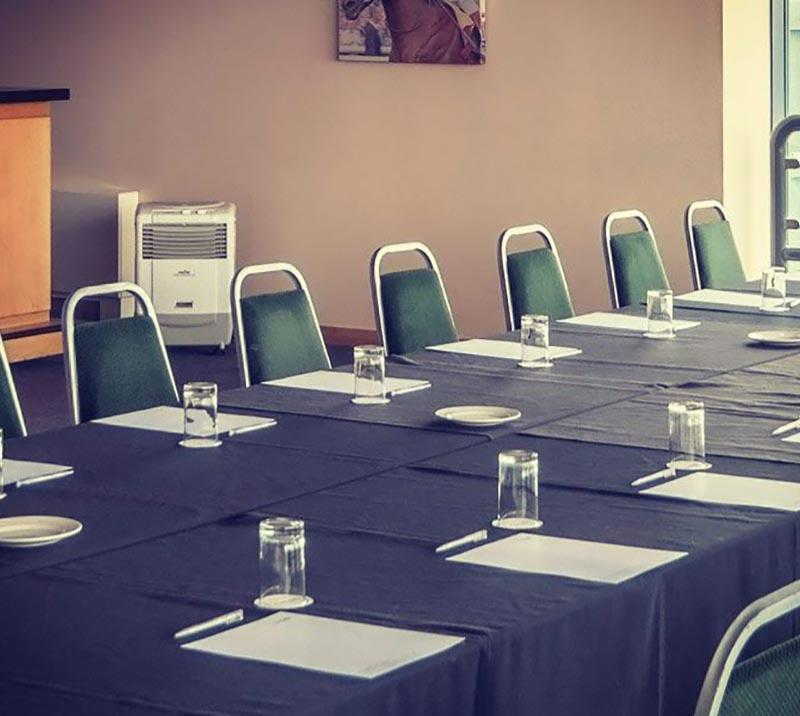 A table cleanly prepared for a business meeting at Doncaster Racecourse.