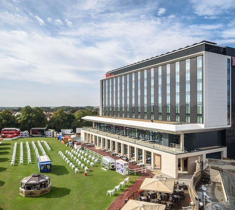 A summertime view of the exterior of the Hilton Garden Inn Hotel at Doncaster Racecourse.