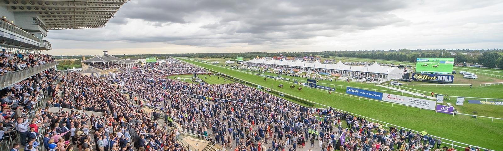 Crowds in the main grandstand at Doncaster Racecourse